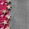 Wooden grey shabby christmas background in red with reindeer. — Stock Photo #50934275