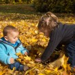 Autumn item: brother and sister having fun in autumn playing wit — Stock Photo #50934515