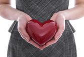 Isolated woman holding a red heart in her hands. — Stock Photo