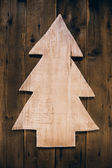 Wooden carved christmas tree for a xmas background. — Stock Photo