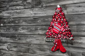 Christmas background of wood decorated with a tree of red balls. — Stockfoto