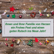 Christmas card with colorful decoration and german text merry ch — Stock Photo #50955263