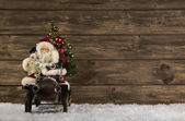 Santa Claus: Vintage christmas decoration on wooden brown backgr — Stockfoto