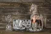 Silver and beige christmas decoration with present, angel, horse — Stock Photo