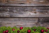 Wooden christmas frame with green moss and red balls for a frame — Stock Photo