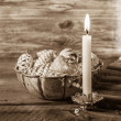 Vintage or shabby chic christmas background with one burning can — Stock Photo #50997689