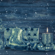 Dark blue christmas decoration with candle and presents on woode — Stock Photo #50999697