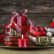 Red christmas decoration on wooden background with carousel. — Foto Stock #50997711