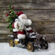 Christmas decoration: Red santa claus in hurry to buy christmas  — Stock Photo #50999545