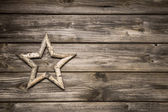 Wooden christmas background with a star for decoration. — Zdjęcie stockowe