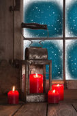 Traditional christmas decoration in red: four burning candles de — Stock Photo