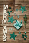 Merry Xmas greetings of wooden letters. Christmas decoration in  — Stock Photo