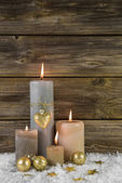 Traditional christmas decoration with four beige burning advent  — Stock Photo
