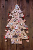 Handmade christmas tree of wood decorated with gingerbread. — Stock Photo