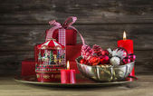 Red christmas decoration on wooden background with carousel. — Stockfoto