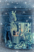 Shabby chic christmas decoration in silver with wooden horse, ca — Stock Photo