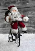 Santa Claus making christmas shopping with his bike. Funny idea — Stock Photo