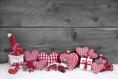 Red white checked christmas decoration on grey wooden background — Stock Photo