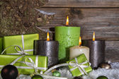Decoration: four green and brown burning advent candles for chri — Stock Photo