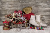 Old children toys on wooden background for christmas decoration. — Stock Photo