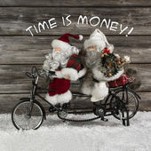 Time is money -  santa claus team in hurry for buying christmas  — Stock Photo