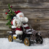 Christmas decoration: Red santa claus in hurry to buy christmas  — Stock Photo