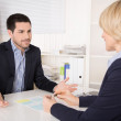 Job interview or meeting situation: business man and woman at de — Stock Photo