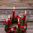 Four red burning advent candles on wooden background for christm — Stock Photo #51214523