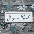 Merry Christmas card in blue and white with french text on woode — Stock Photo #51215319