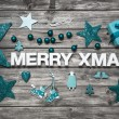 Merry christmas letters in white with turquoise decoration for a — Stock Photo #51215669
