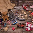 Christmas memories in childhood: old and tin toys on wooden back — Stock Photo #51219087
