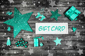Christmas gift card for a xmas coupon decorated in mint green, w — Zdjęcie stockowe