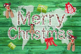 Merry christmas greetings with text on green wooden background - — Stock Photo