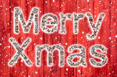 Merry  Christmas greeting card with text of a collage in red Col — Foto Stock