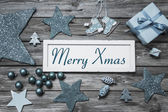 Merry Xmas greeting card with white wooden sign and blue turquoi — 图库照片