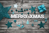 Merry christmas letters in white with turquoise decoration for a — Stock Photo