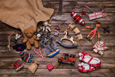 Christmas memories in childhood: old and tin toys on wooden back — Stock Photo