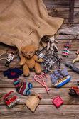 Presents and gifts of Santa's sac: old wooden antique toys for c — Stock Photo