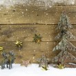 Wooden country style christmas background with reindeer and snow — Stock Photo #51229553