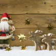 Christmas decoration: Santa Claus with wooden reindeer on backgr — Stockfoto #51229957