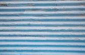 Surface of an old painted blue tin background with panels. — Stock Photo