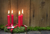 Advent or christmas wreath with four red wax candles. — Stock Photo