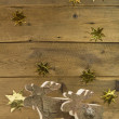 Two wooden elks on wooden christmas background. — Stock Photo #51230289