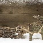 Handmade elk or reindeer with slide of wood on wooden background — Stock Photo #51231199