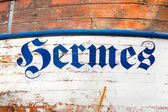 """The word or name """"Hermes"""" on a old wooden ship in antique shabby — Stock Photo"""