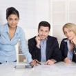 Portrait: successful smiling business team of three people. Man and woman. — Stock Photo #51254331