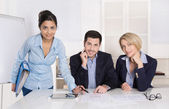 Portrait: successful smiling business team of three people. Man and woman. — Stock Photo