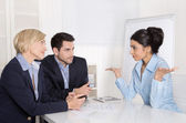 Job interview or business meeting: man and woman sitting at the  — Stock Photo