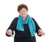 Funny isolated older lady in blue making thumbs down gesture. — Stock Photo