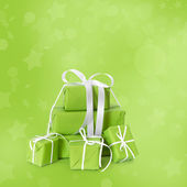 Green christmas presents isolated on green background. — 图库照片
